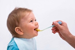 Portrait of Baby Being Fed